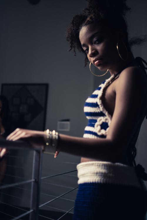 Woman Standing Beside Railing