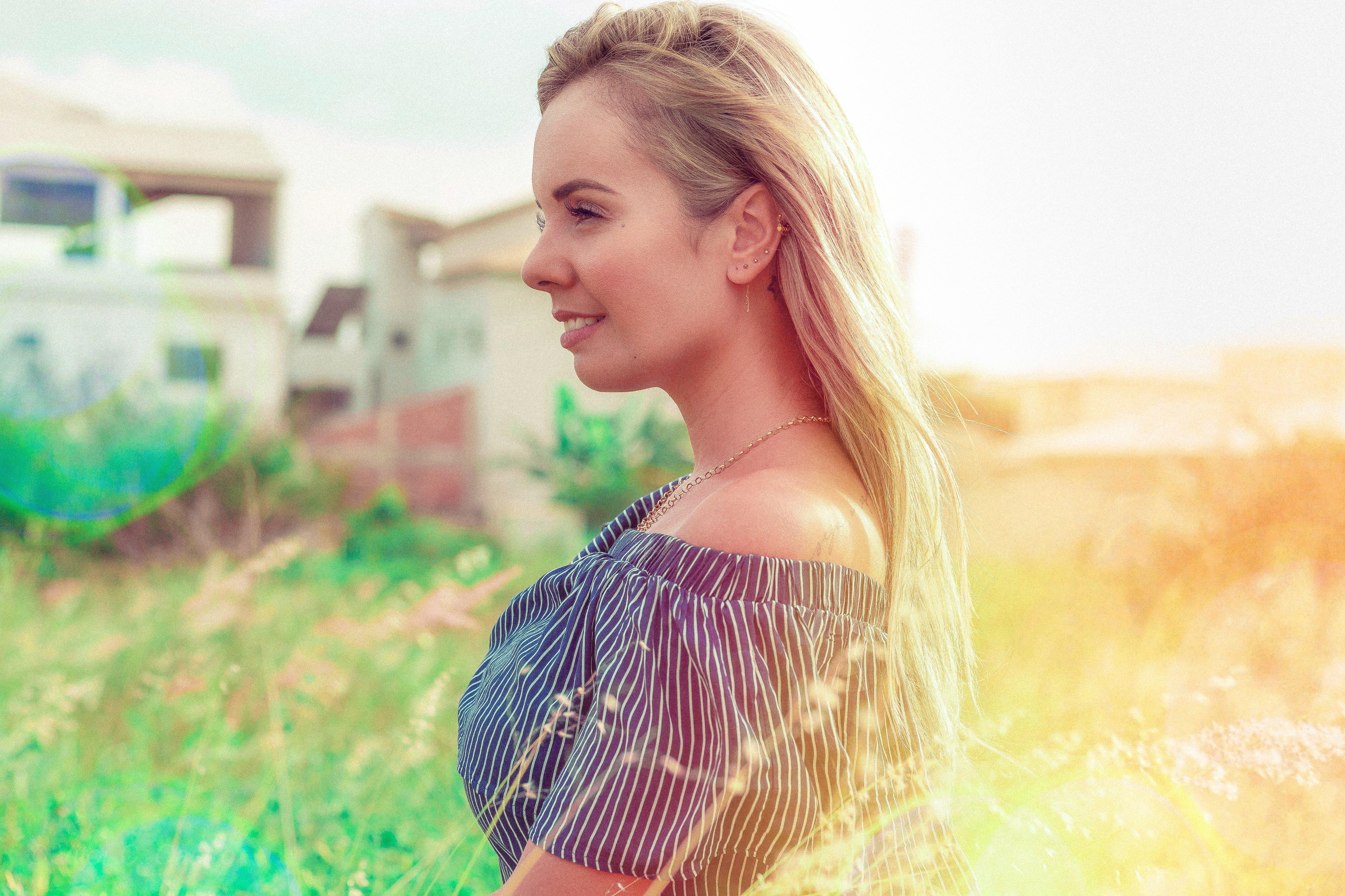 Free stock photo of blond, brazilian woman, flower, morning sun