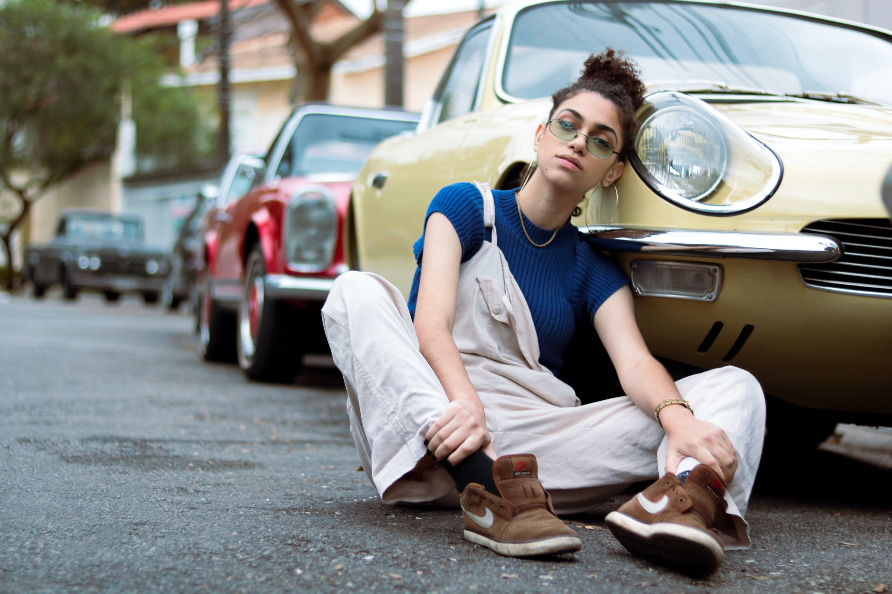 Woman Leaning On Car