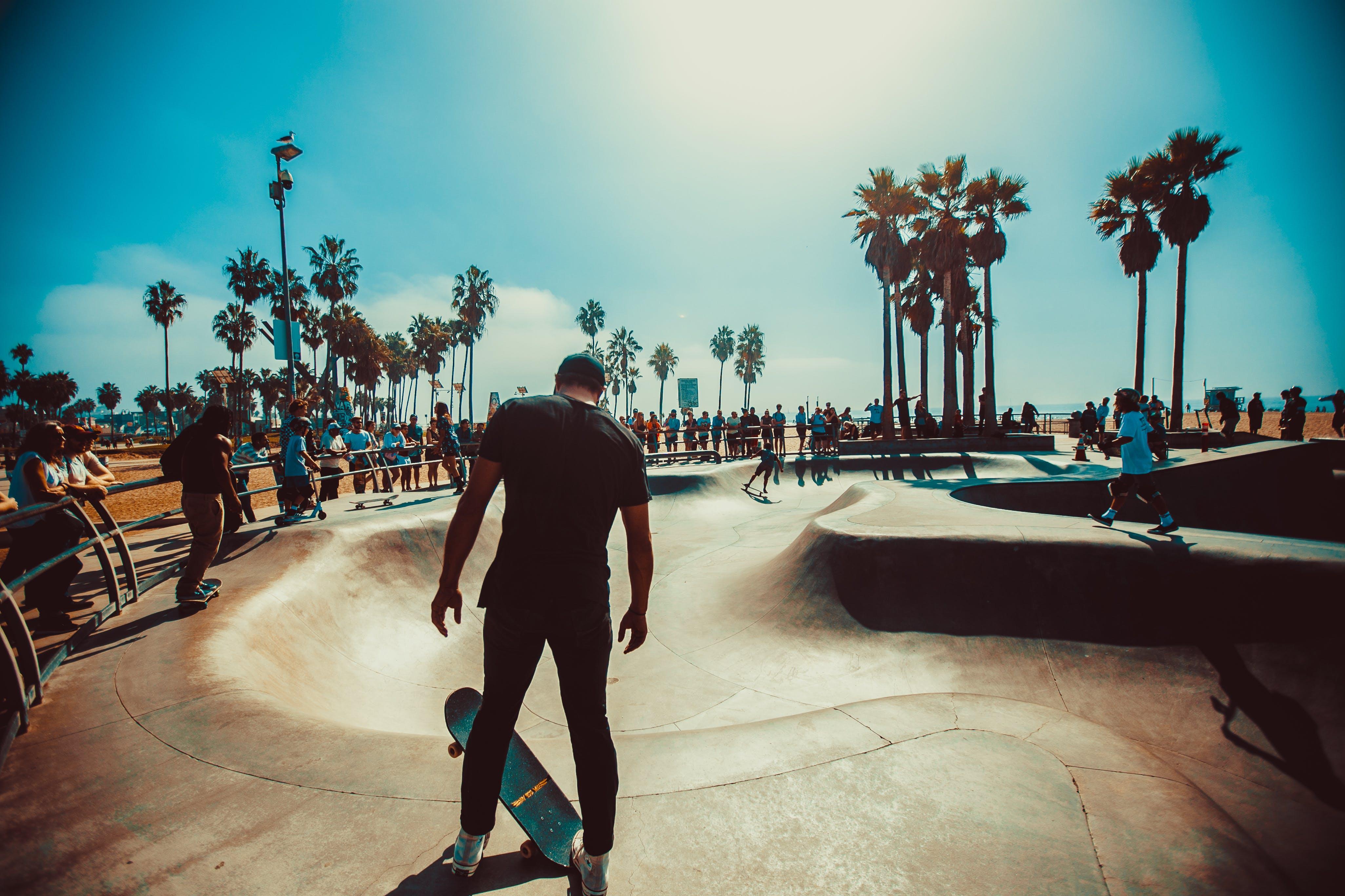 Man Standing on Skateboard Near Skate Park