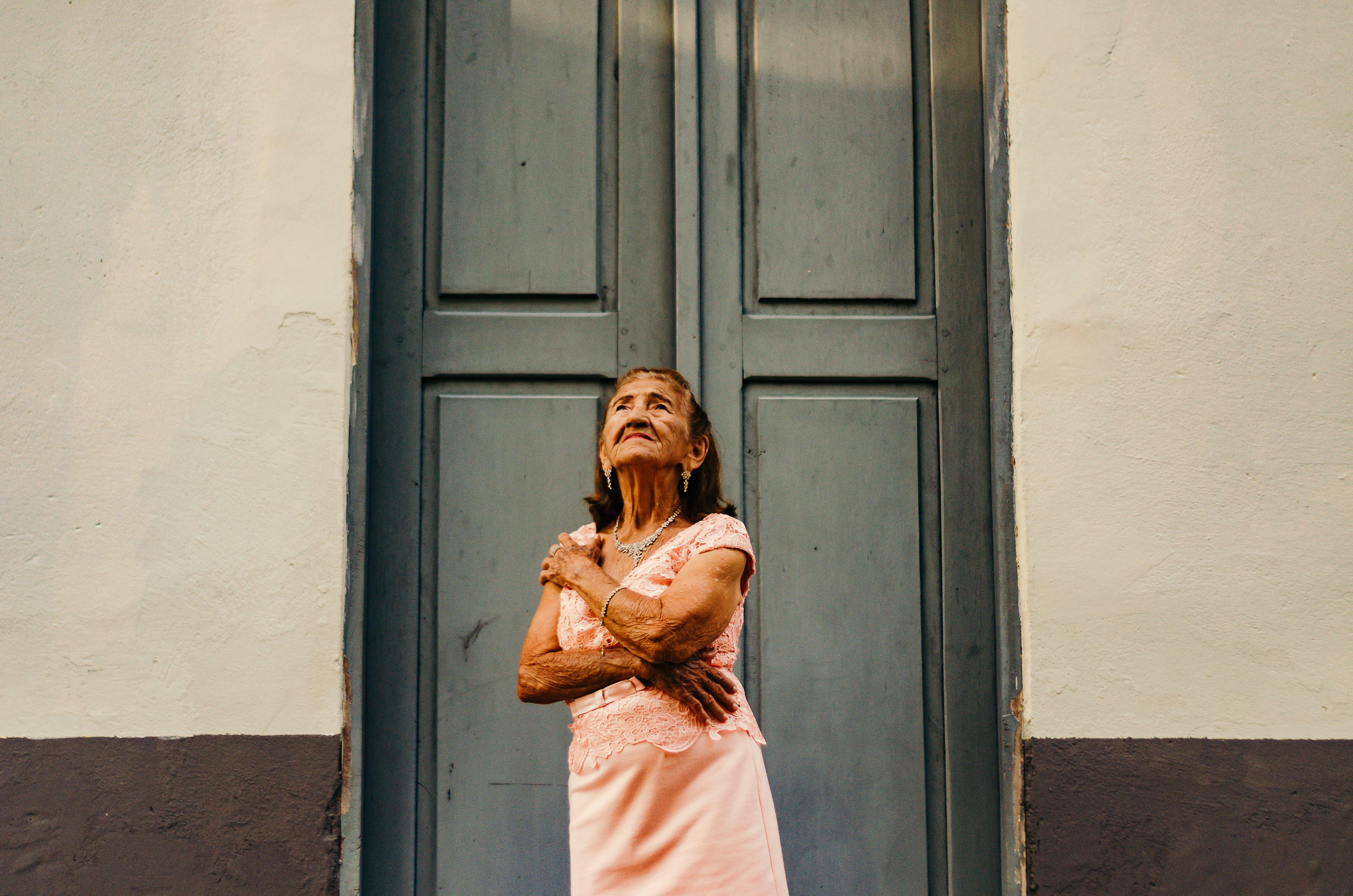 Woman Standing in Front Close Door