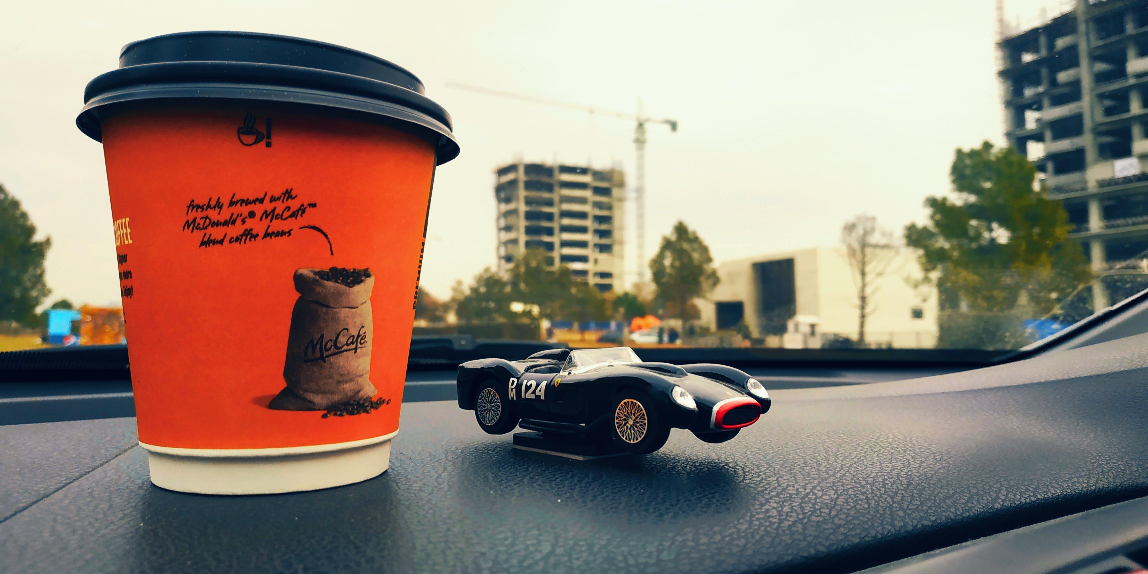 Free stock photo of coffee cup, construction work, focus, orange