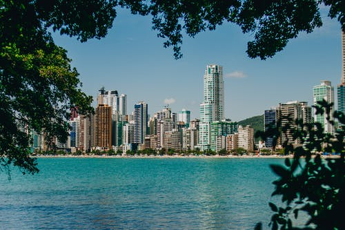 Picturesque view of modern skyscrapers and amazing blue water