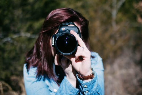 Woman Holding Canon Dslr Camera