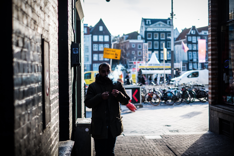 Man Walking Through an Alley