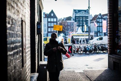 Foto d'estoc gratuïta de amsterdam, carrer, ciutat, home