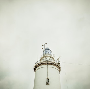 White Light House Under White Sky