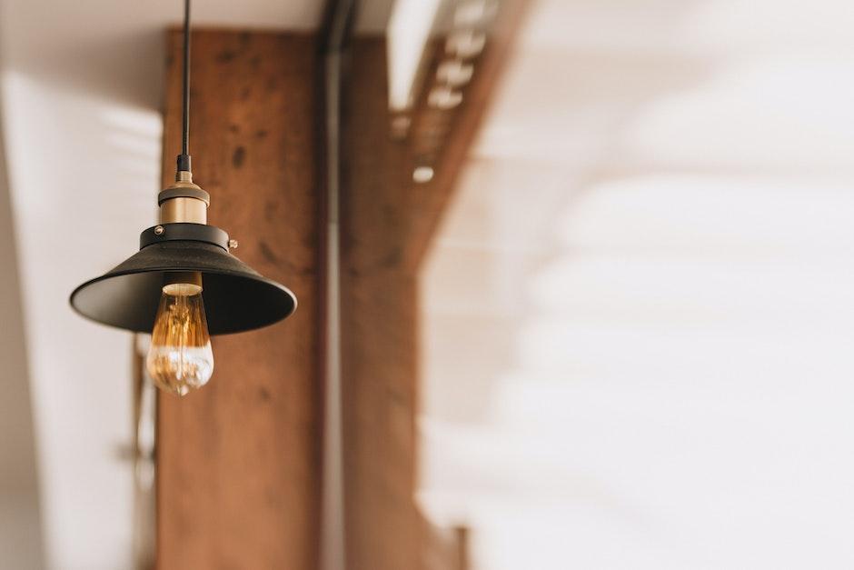 Shallow Focus Photography of Black and Orange Pendant Lamp