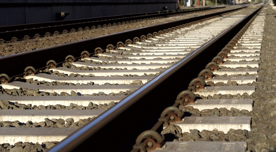 Black and Gray Metal Train Rail