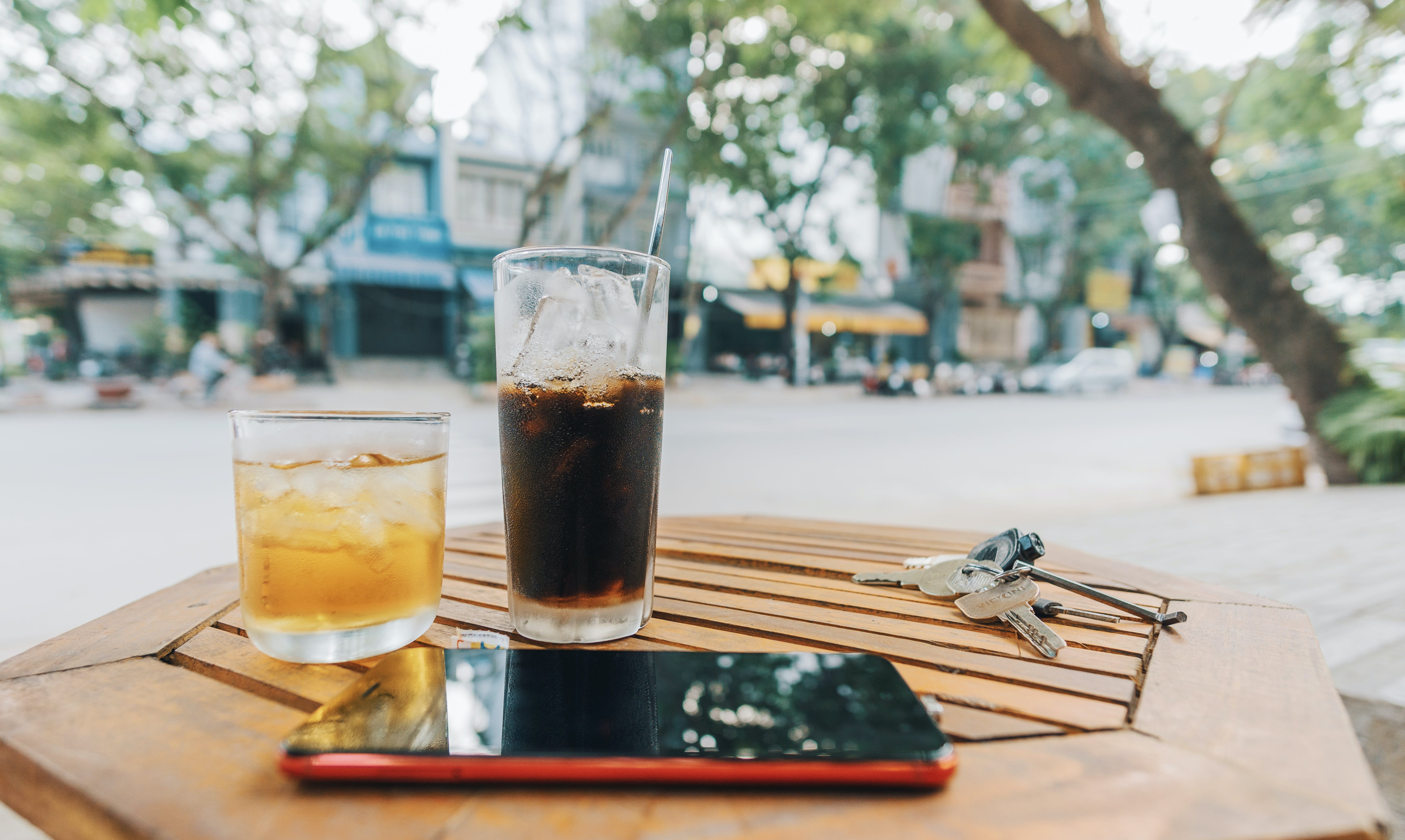 Drinks on top of a Brown Wooden Table