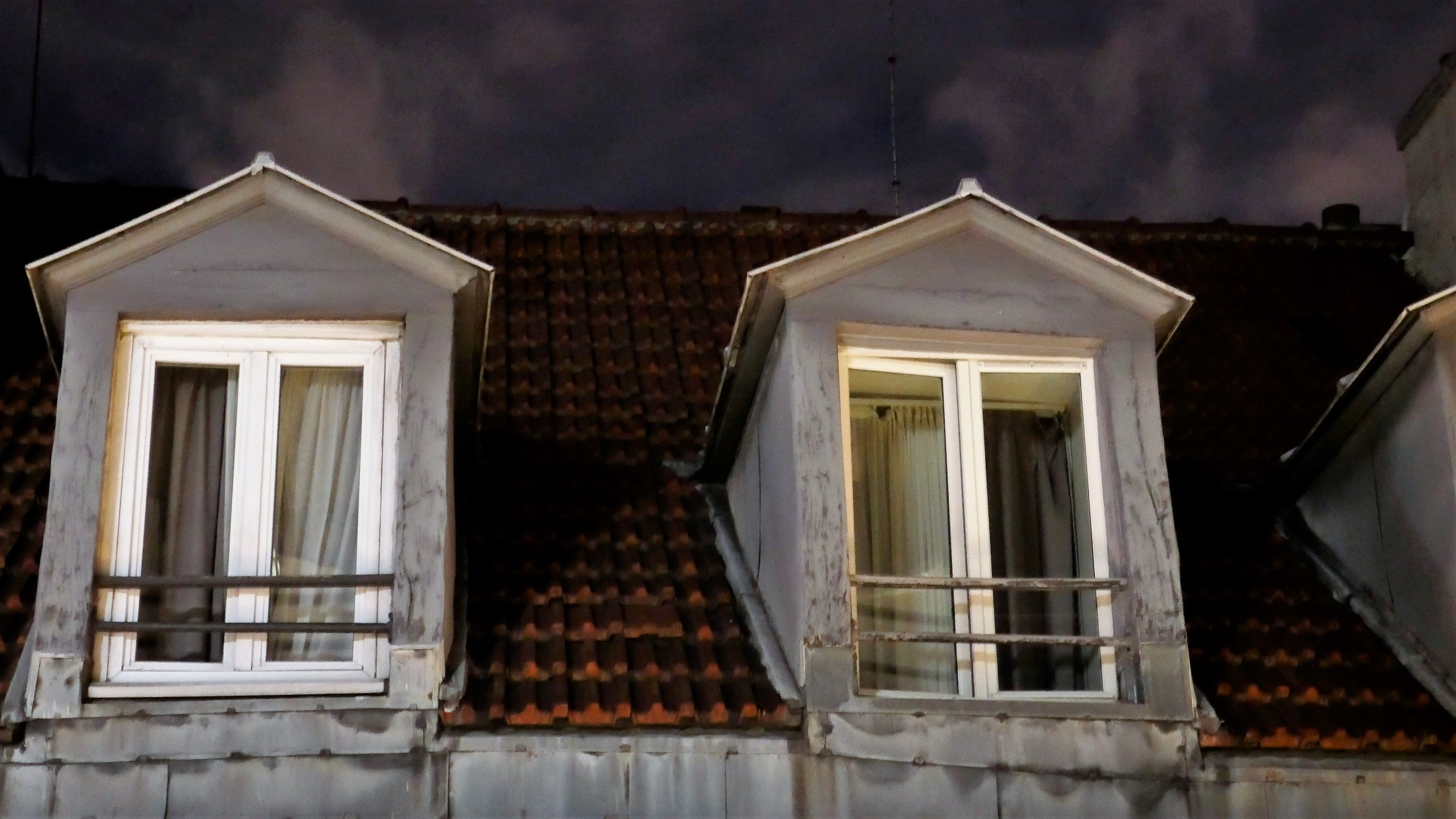 Free stock photo of Night view on typical mansard roof in Paris