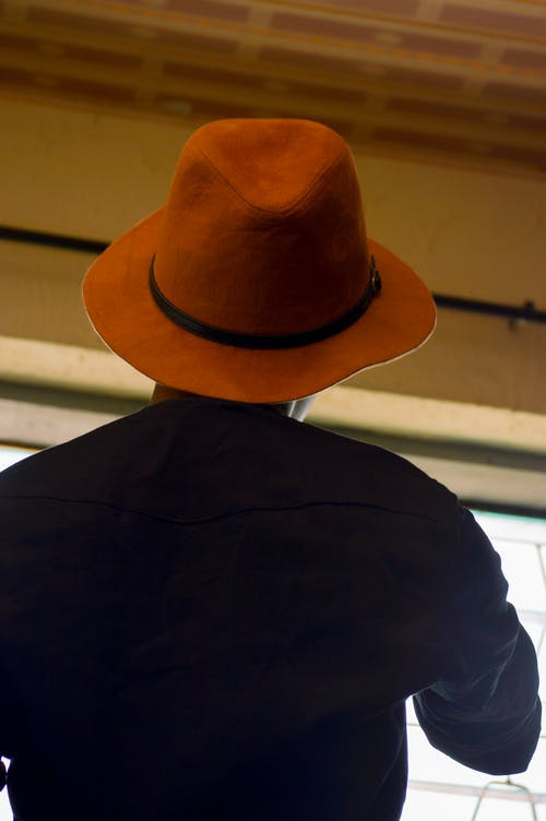 Free stock photo of african woman, back view, brown hat, nigerian