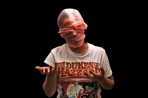 Photo of Person Wrapped With Plastic Mask