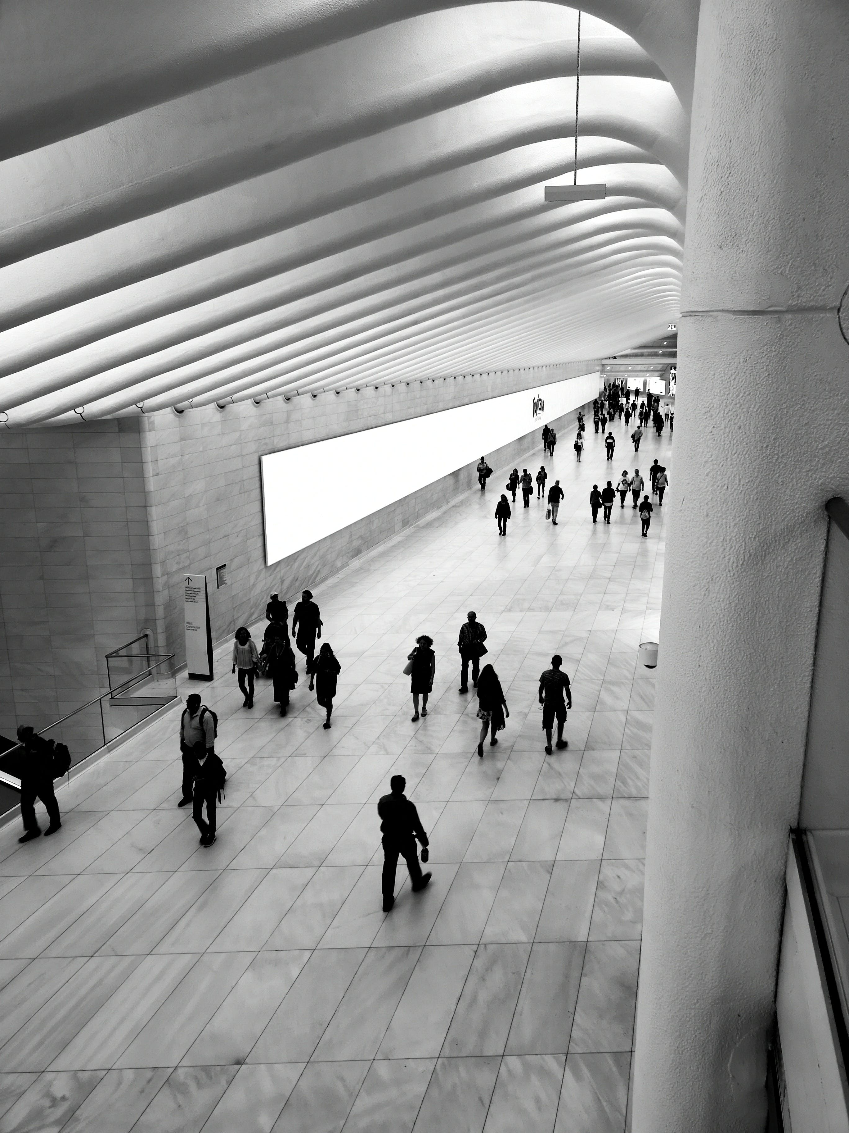 Black and White Photograph of People Walking at the Subway