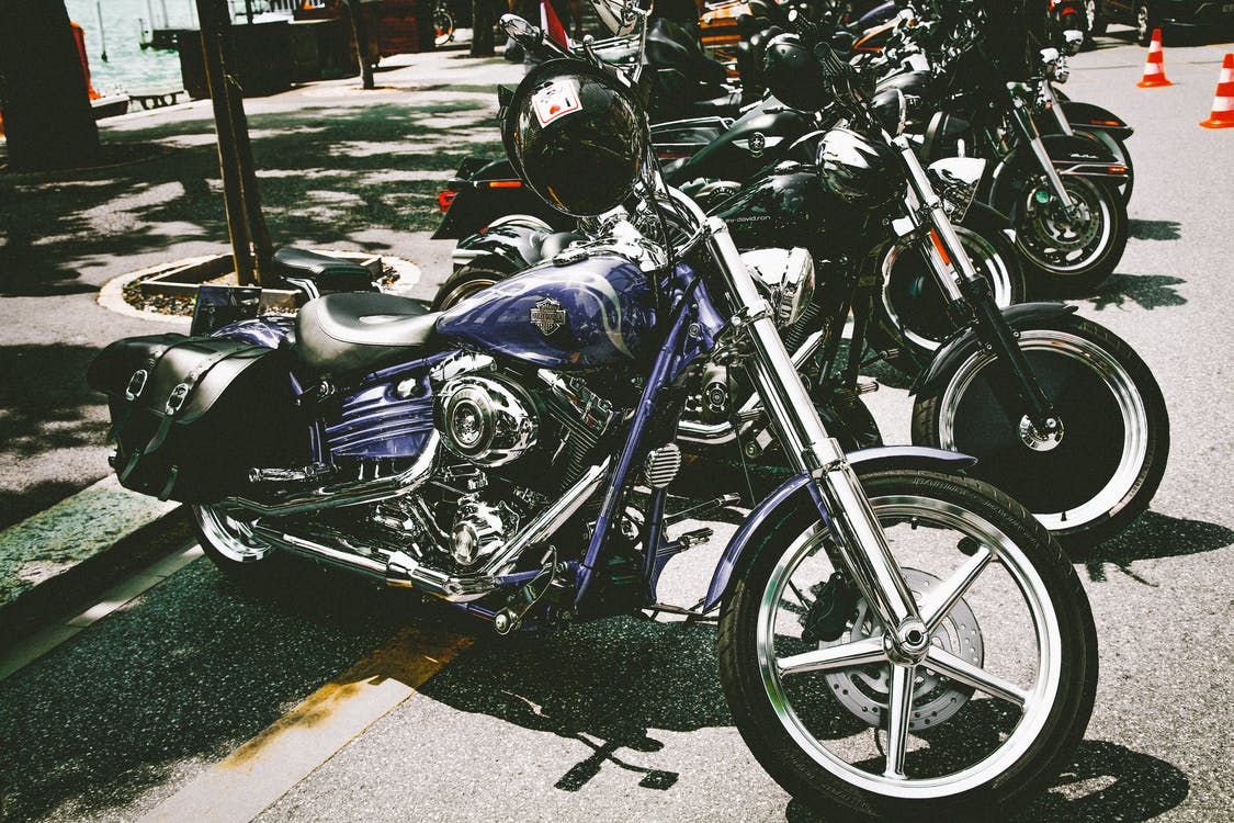 Photograph of Motorbikes Parked on the Street