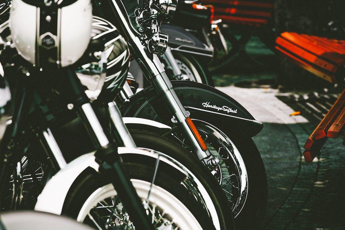 Parked Black and White Cruiser Bikes