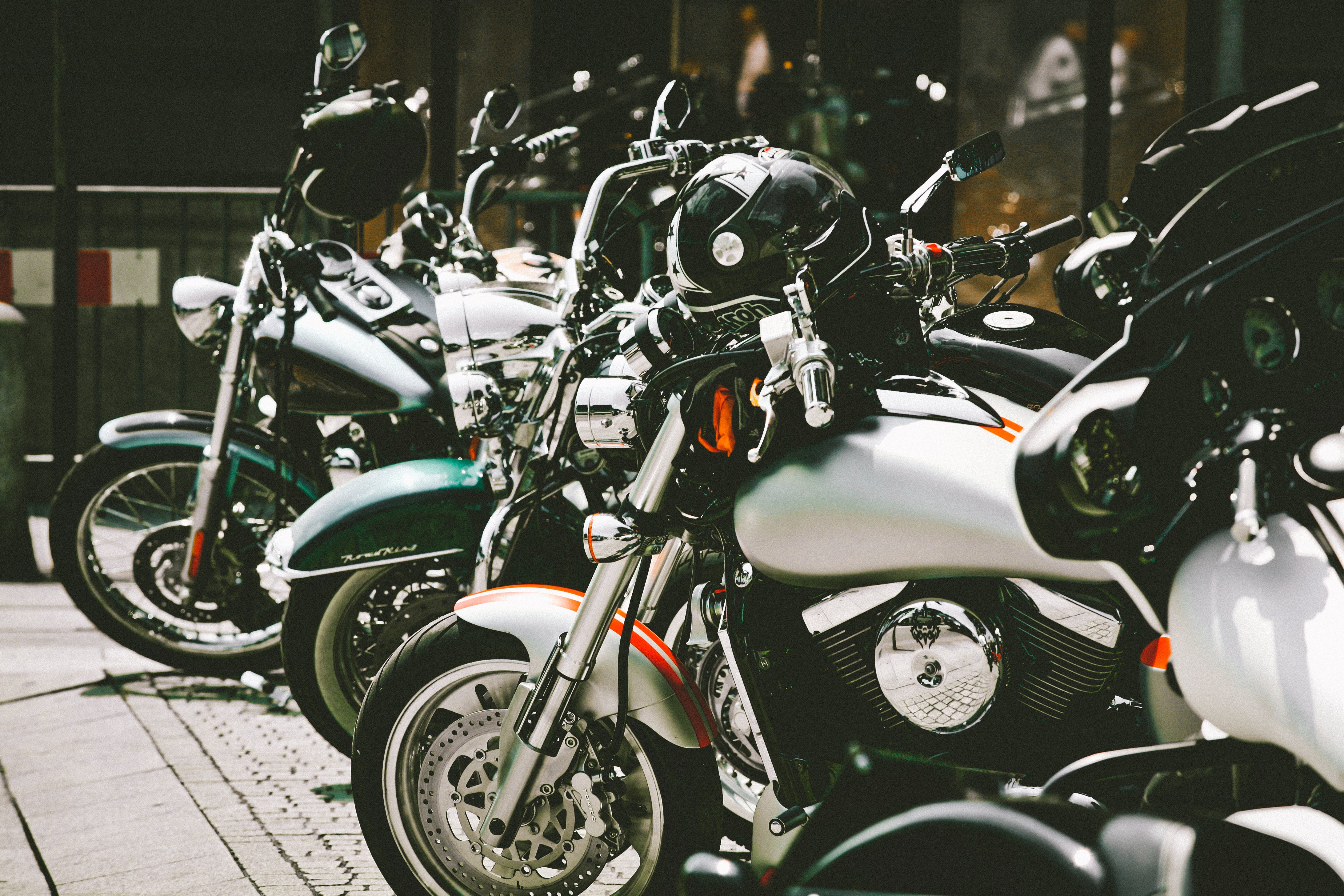 Photo of Motorcycles Parked on Pavement