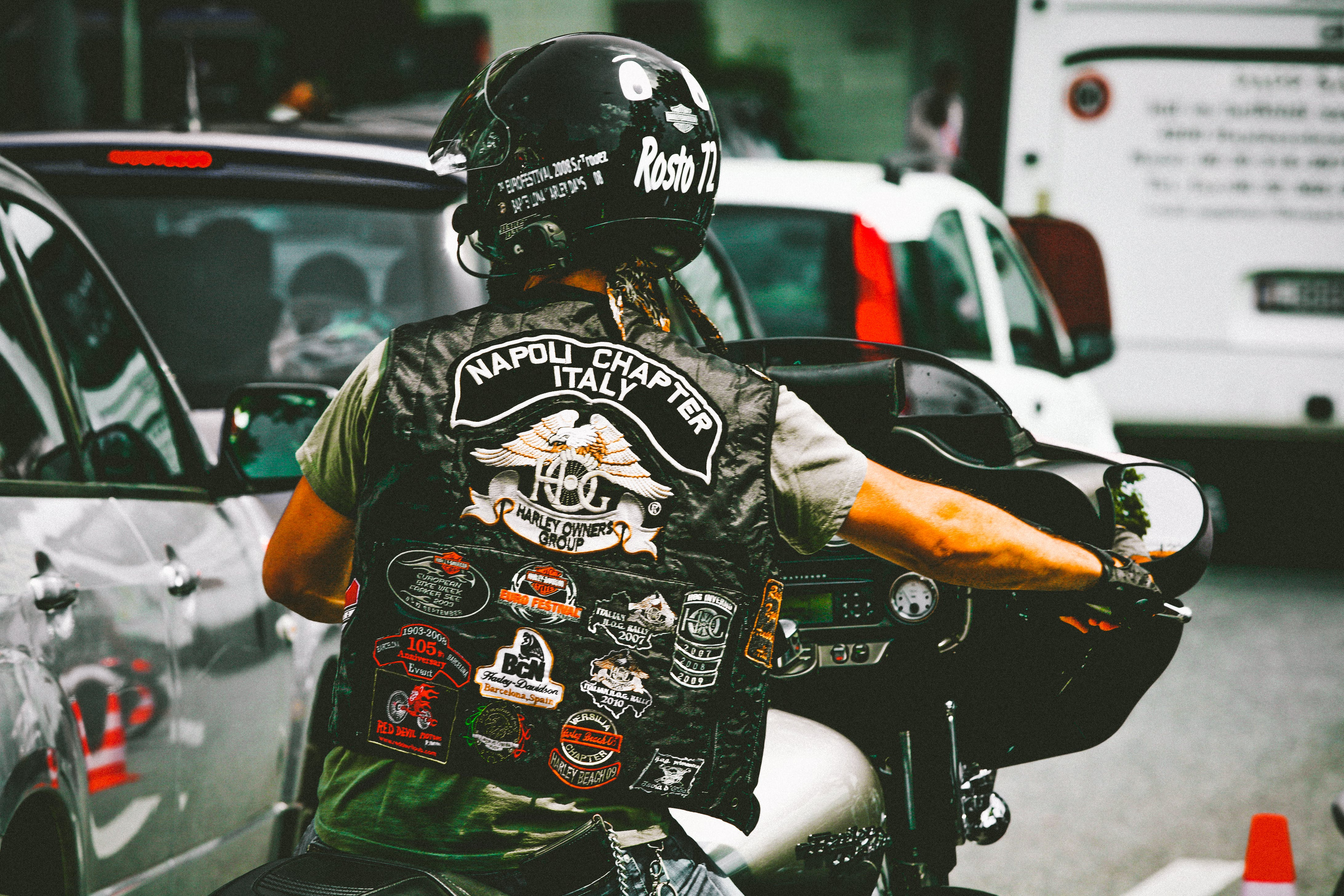 Photo of Person Riding Harley Davidson Motorcycle
