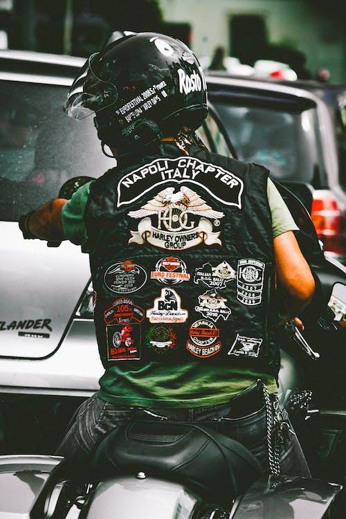 Photo of Man Riding Harley Davidson Motorcycle