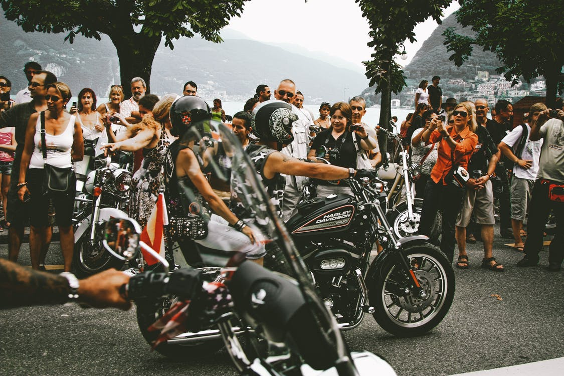 Photo of Two Persons Riding Motorcycle