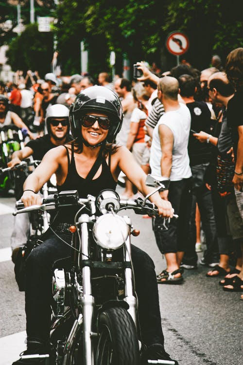 Photo of Woman Wearing Shirt While Riding Motorcycle