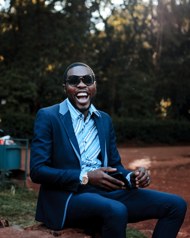 Photo of Smiling Man Wearing Suit
