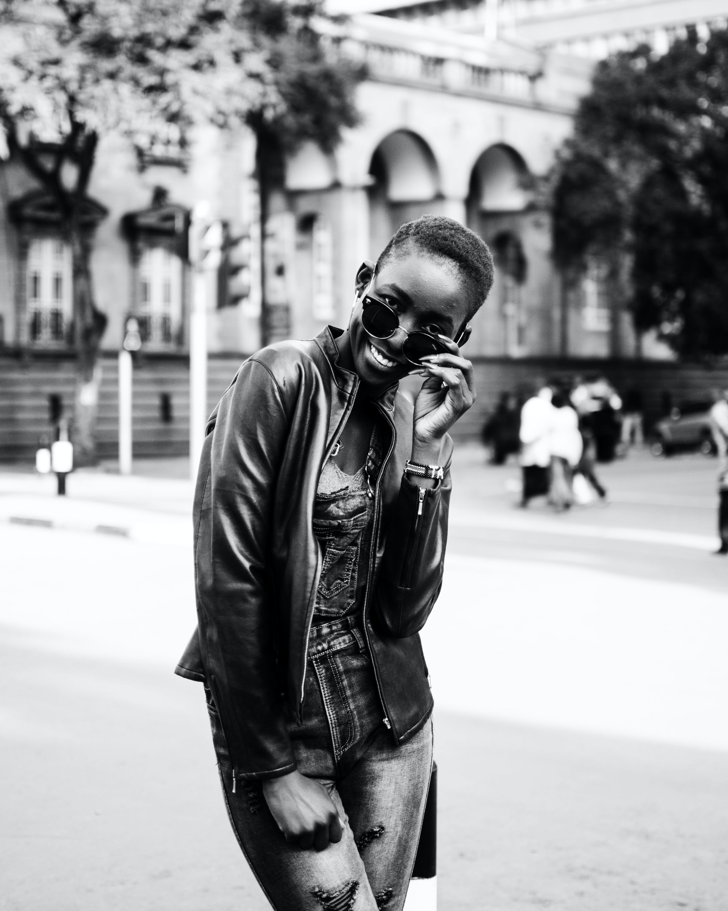 Monochrome Photo of Woman Wearing Leather Jacket