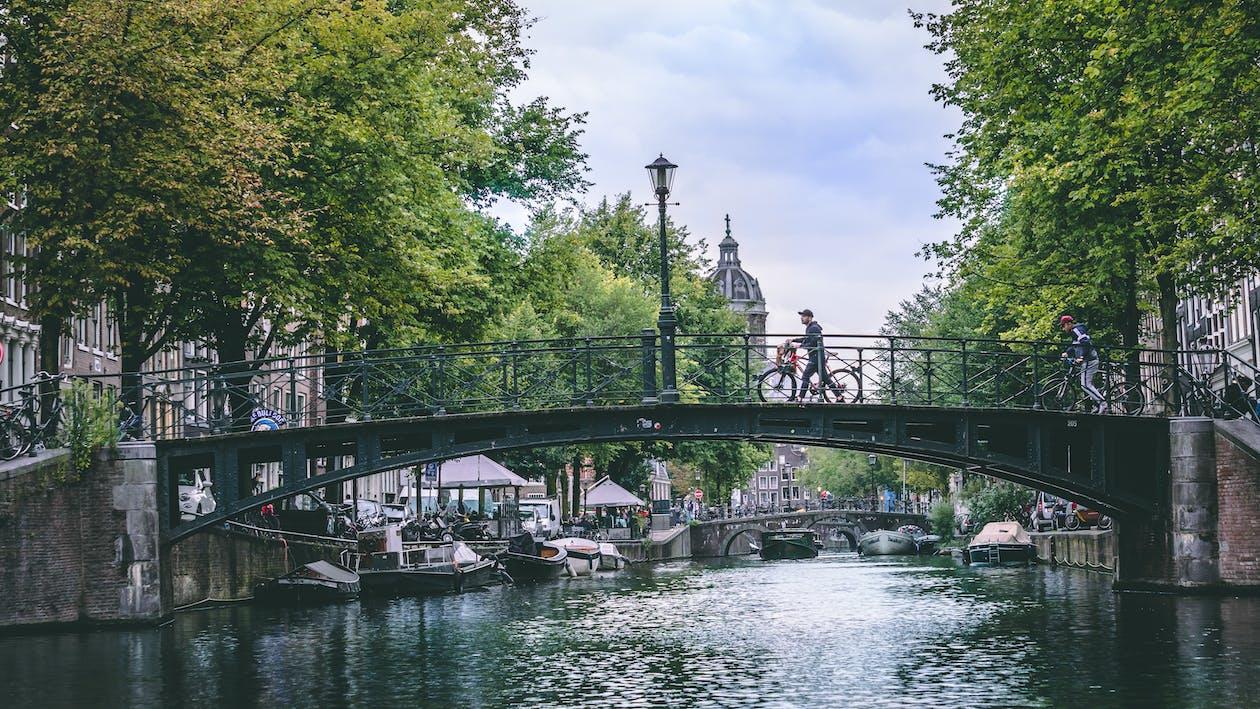 Person Crossing The Bridge