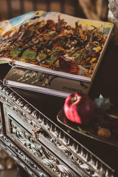 Photo of Illustration Books on Top of Wooden Table