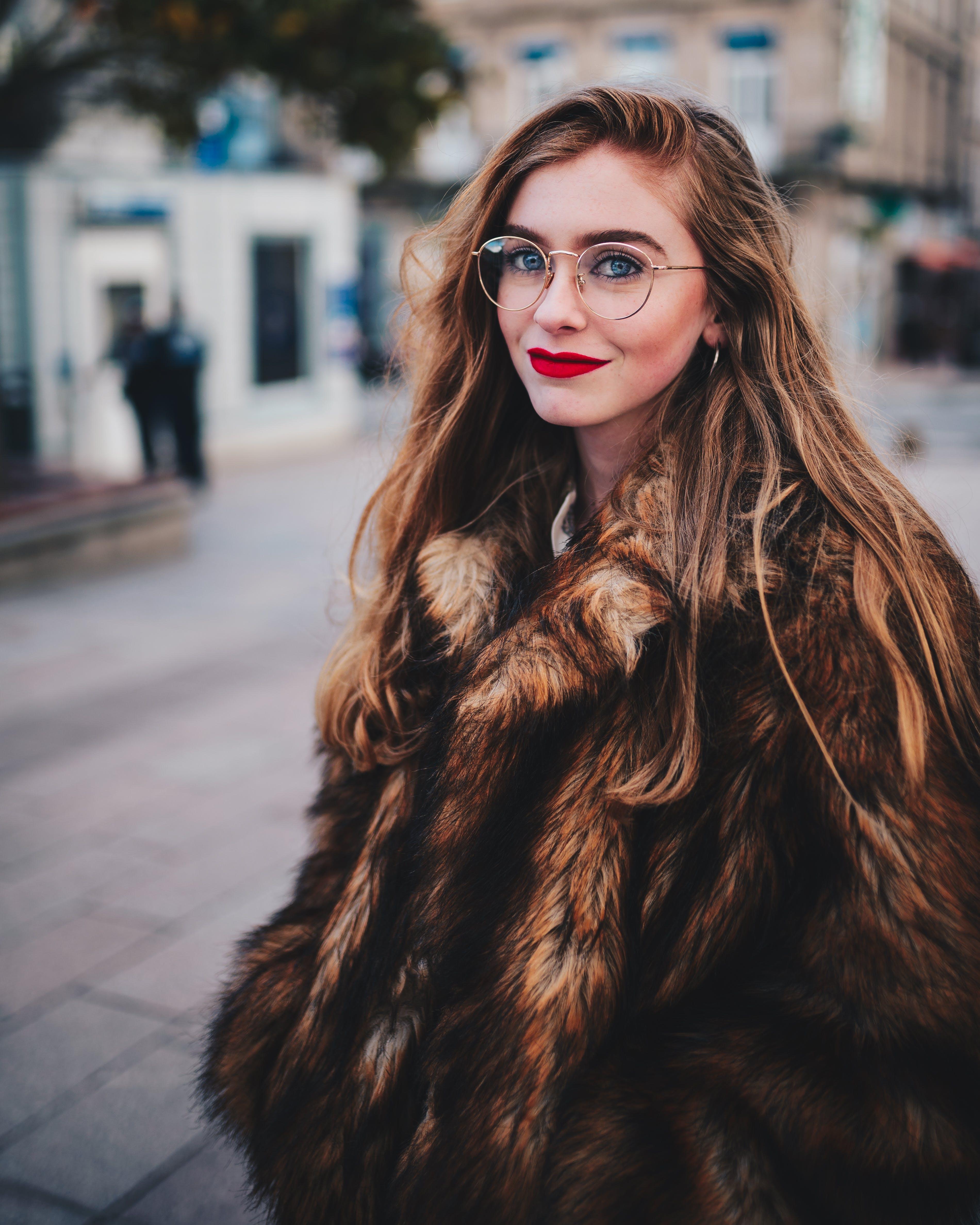 Photo of Woman Wearing Faux Fur Coat