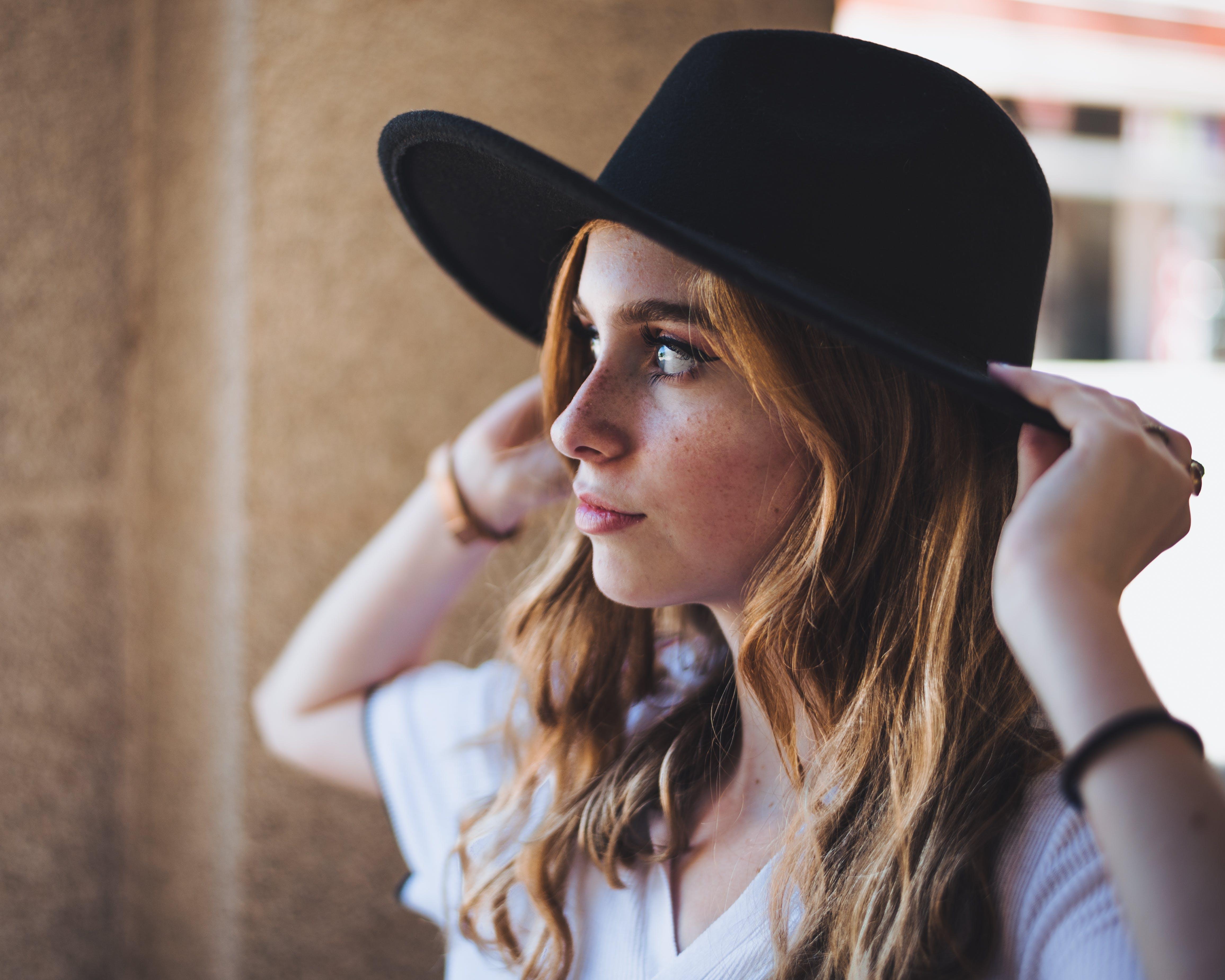 Close-Up Photo of Woman Wearing Fedora Hat
