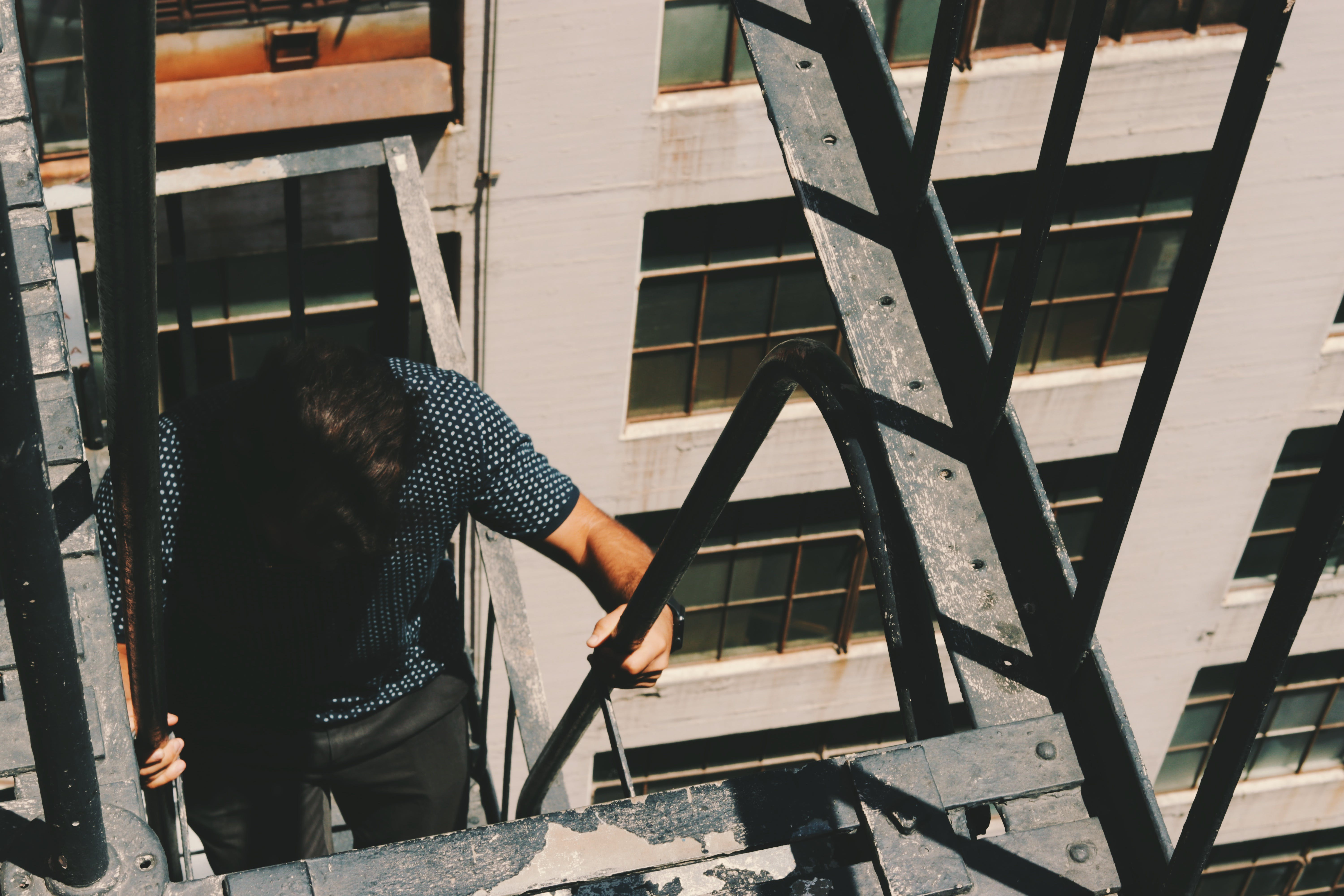 Man Climbing Side Building Stairs