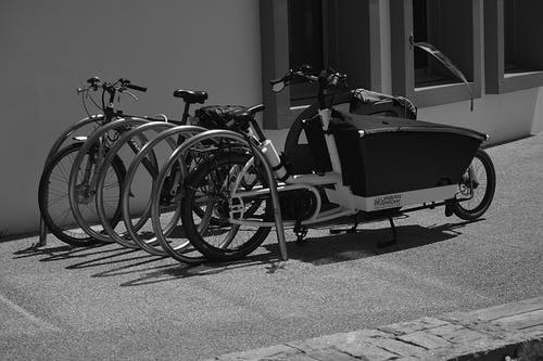 Greyscale Photo of Utility Bike during Daytime