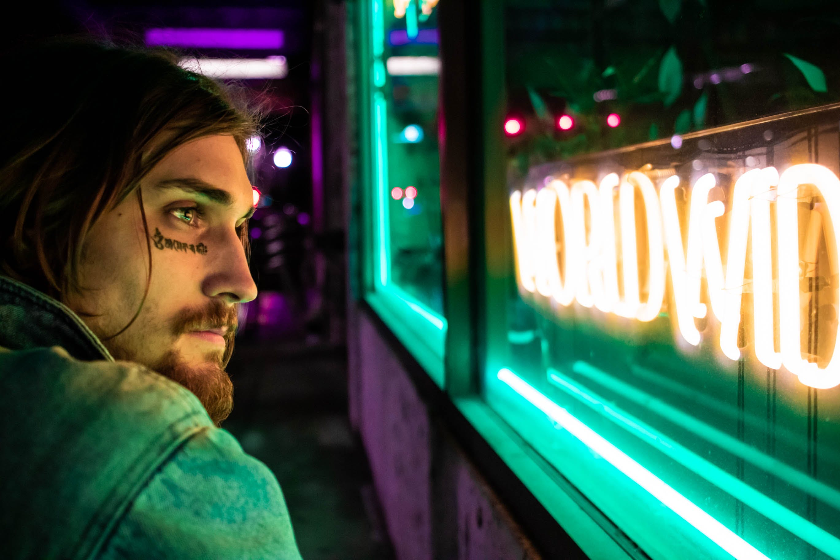 Man Near Neon Sign