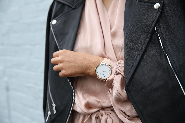 woman's hand wearing a luxury watch