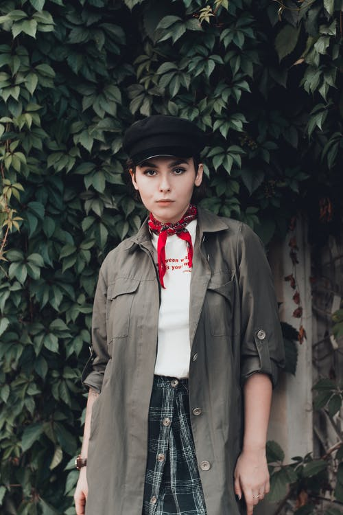 Photo of Woman in Black Hat and Neck Scarf Posing
