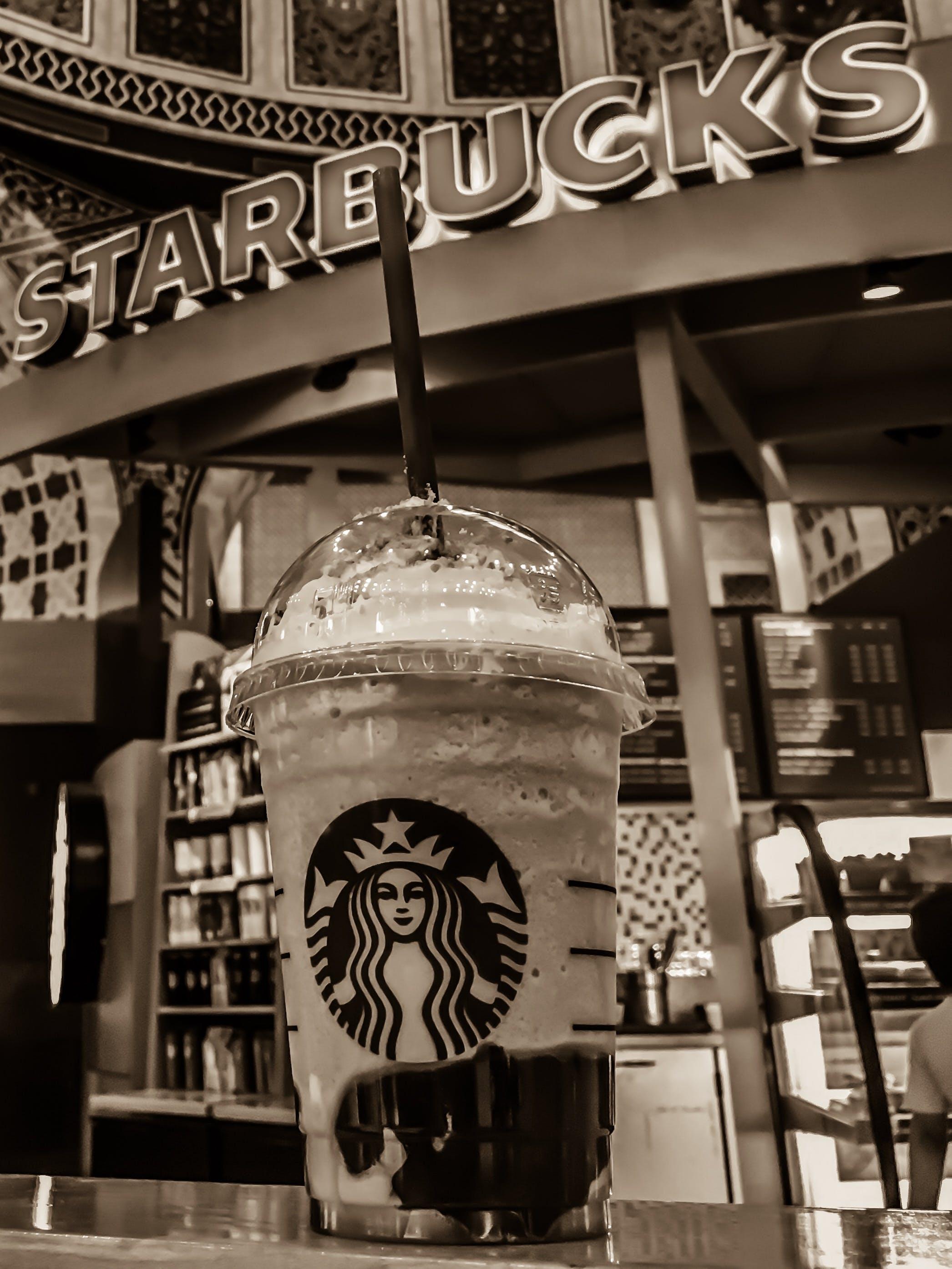 Starbucks Stall Grayscale Photo