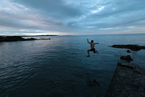 Free stock photo of jump, sea, sky