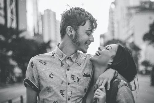 Grayscale Photo of Happy Couple