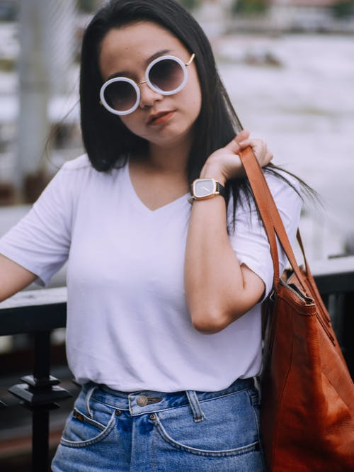 Woman in Sunglasses Holding Bag