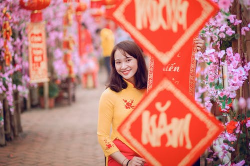 Selective Focus Photo of Woman Wearing Yellow Top