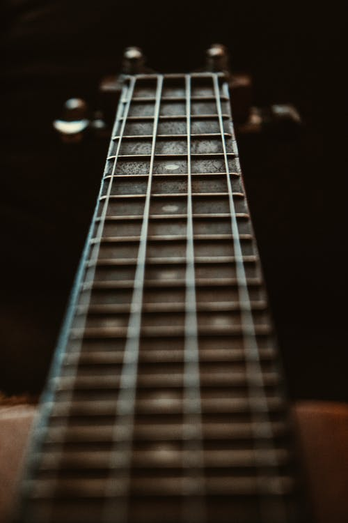 Selective Focus Photo of Fretboard