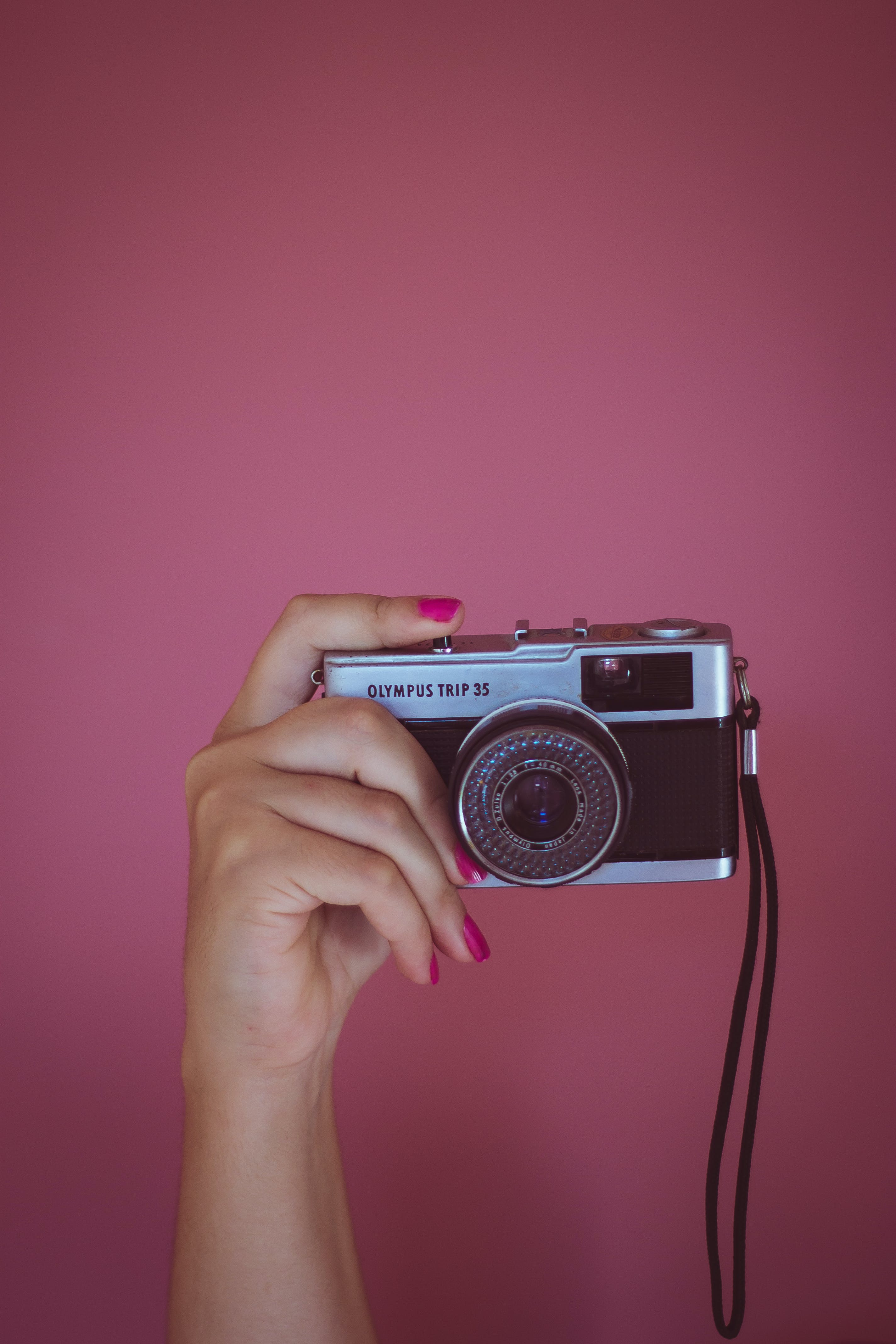 Black Camera With Pink Background