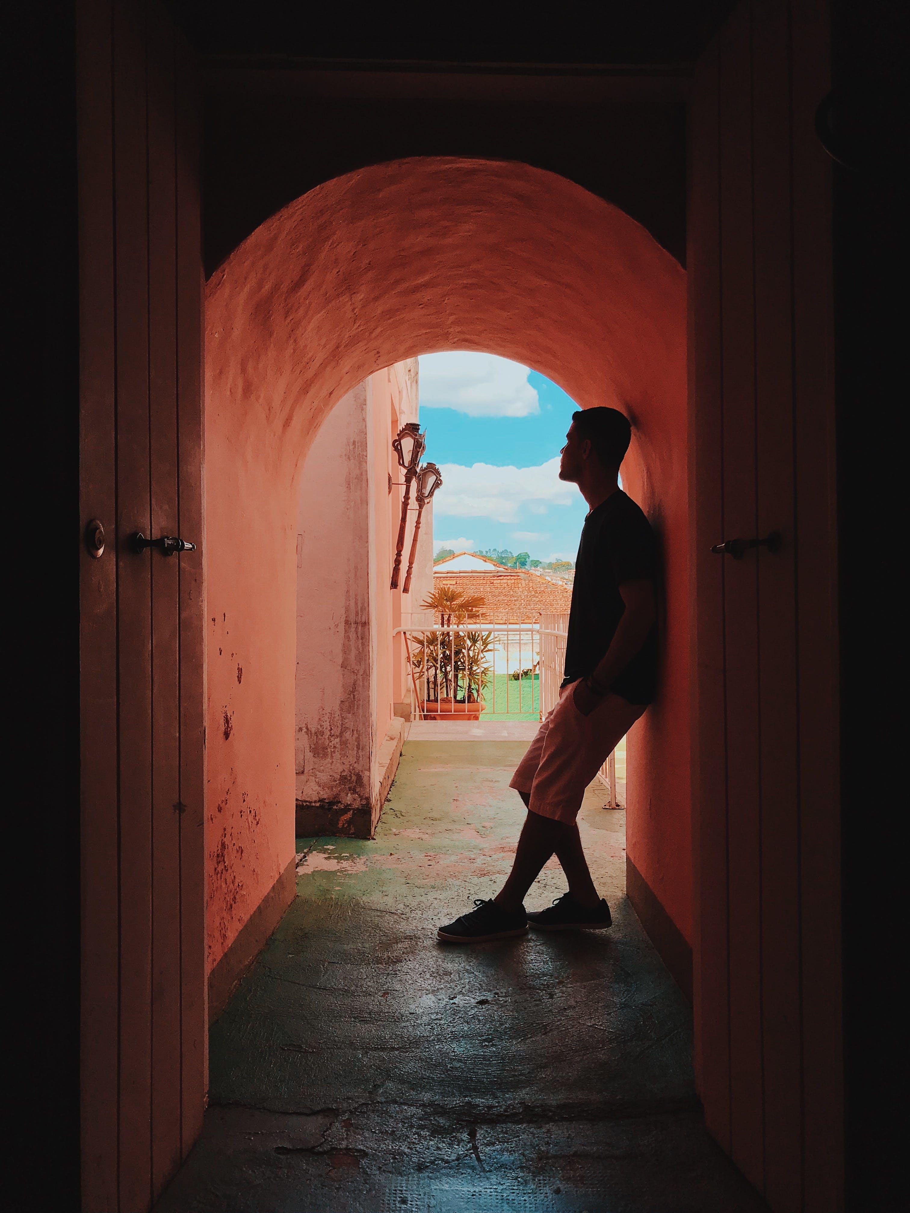 Man Standing In The Hallway