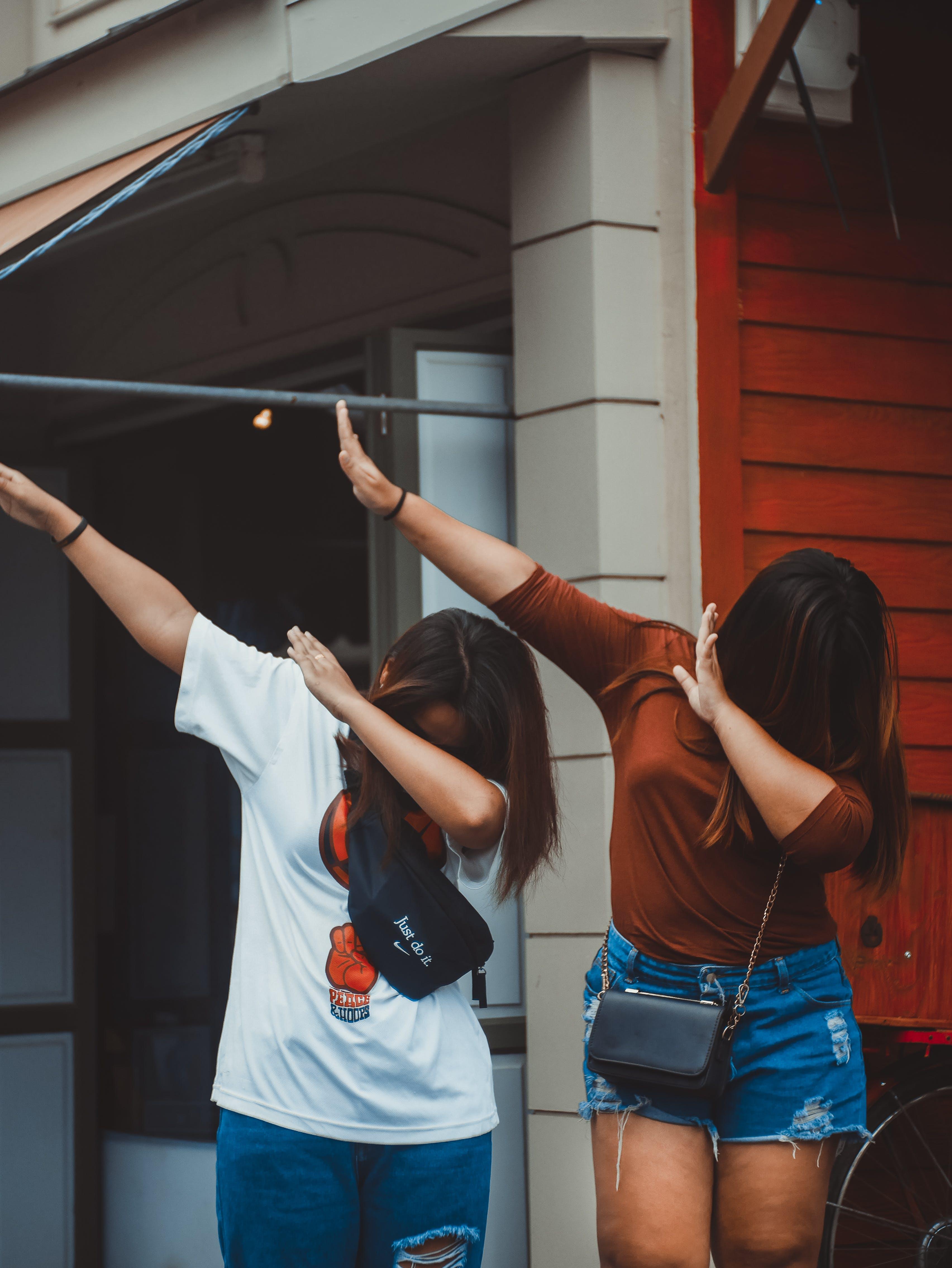 Photo of Two Women Dancing