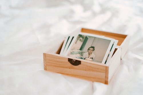 Close-Up Of Pictures On Wooden Box