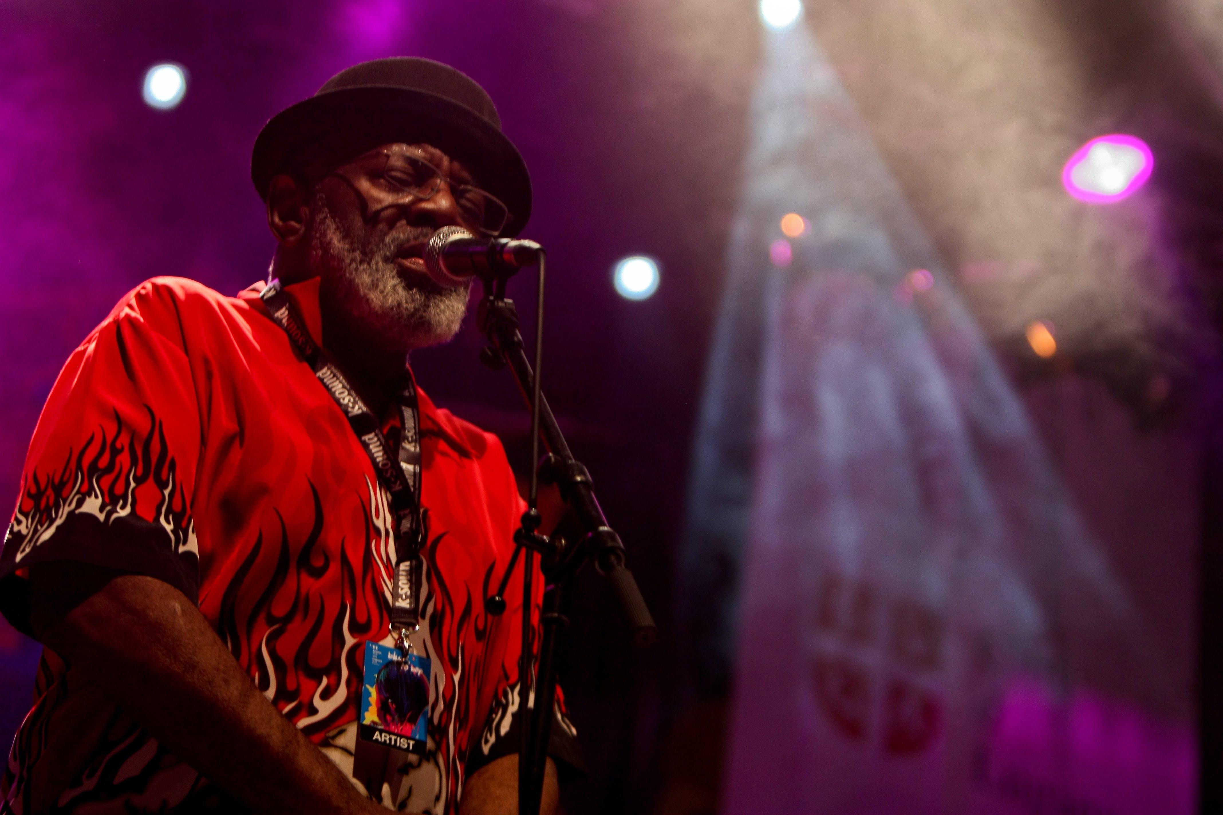 Close-Up Photo of Man Singing