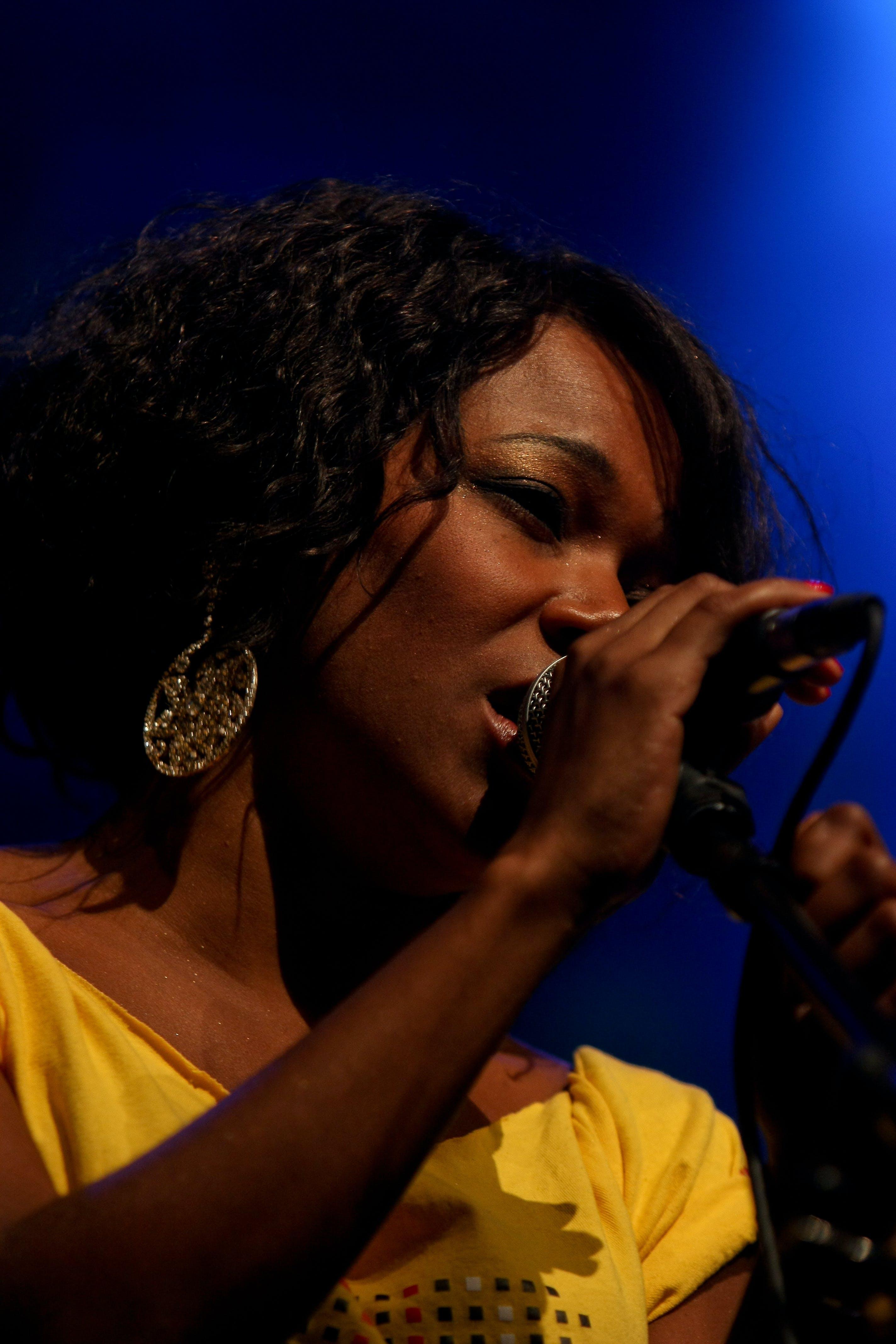 Close-Up Photo of Woman Singing