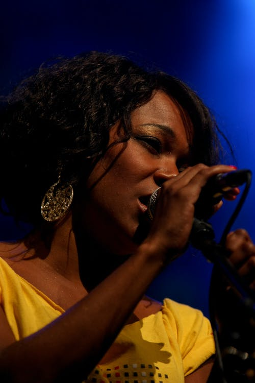 Close-Up Photo of Woman Singing