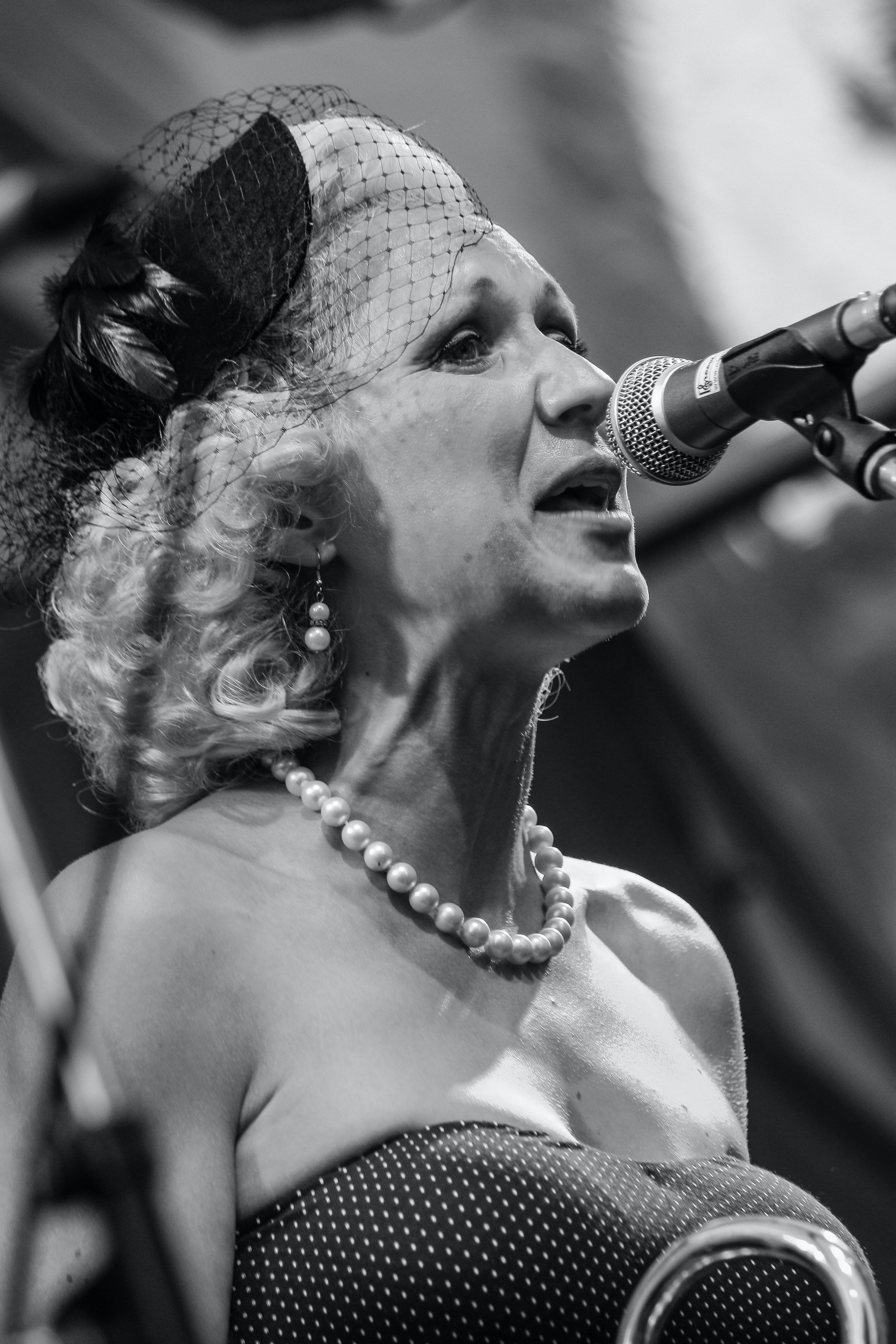 Monochrome Photo of Singing Woman